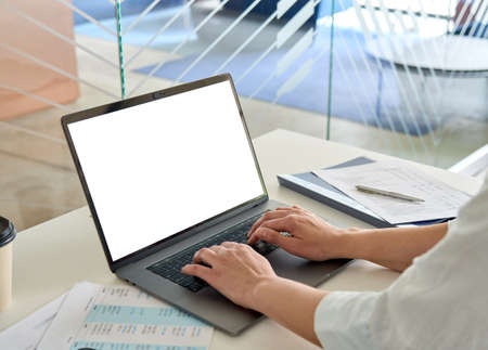 Closeup view of female businesswoman typing on laptop computer keyboard.