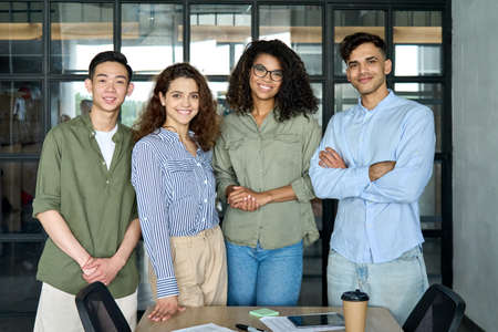 Young multiracial business people team standing in office. Group portrait 免版税图像