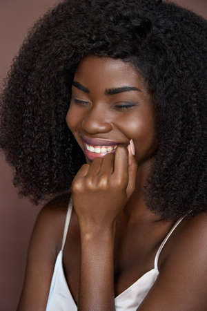 Closeup vertical portrait of young cheerful happy black girl. Beauty concept.