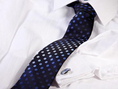 Tie and cuff-link on a white shirt Standard-Bild