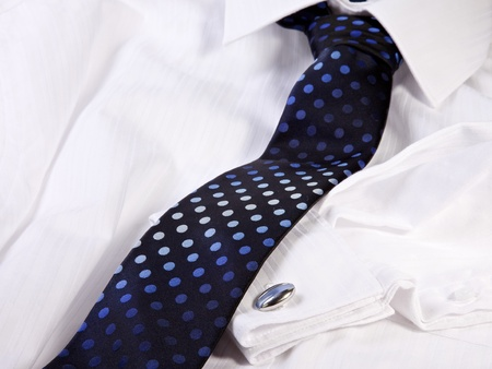 Tie and cuff-link on a white shirt Stock Photo
