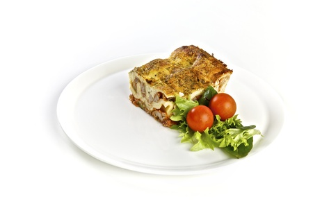 Delicious lasagna with a salad on a plate, lunch or dinner