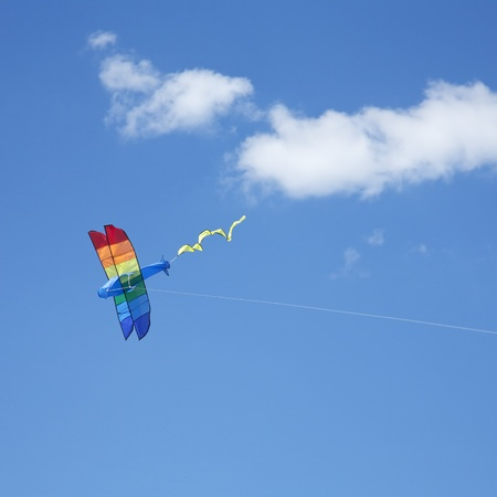 hang glider: Plane kite Flying in the sky with white clouds