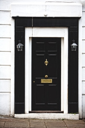 Black and White Wooden Door, part of a home   house Stock Photo - 13838512