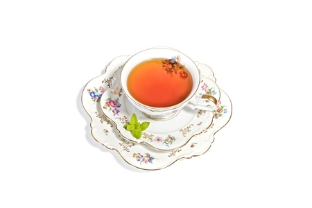 Delicate porcelian cup of tea for a refreshing high tea photo