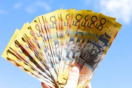 Person holding austalian dollors