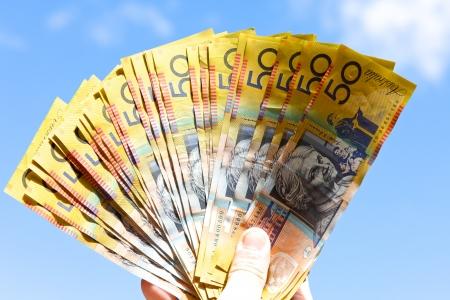 australian dollar notes: Person holding austalian dollors