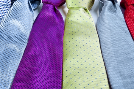 Row of colorful mens ties photo