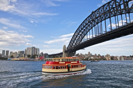 sydney harbour: Sydney Habour Ferry Under the Iconic Sydney Bridge in Circular Quay Stock Photo