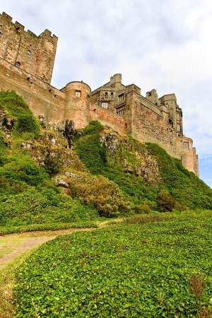 arthur: Coastal Bamburgh Castle in Northumbria, England Holy Island and Grounds Surround the Castle Editorial