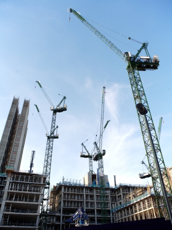 commercial construction: Construction Site with cranes in the city