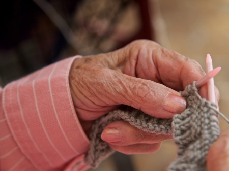 arthritic: Granny knitting Stock Photo