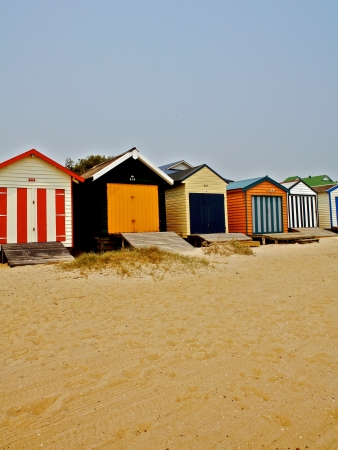 Beach huts at the coast Stock Photo