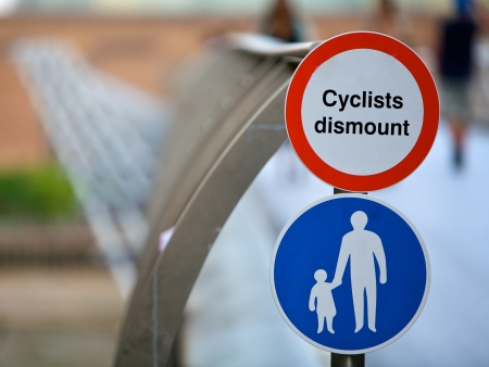 Cyclists track sign for bicycles on a bridge photo