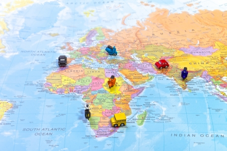World map with magnets on countries