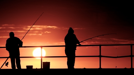 Fishing men at the beach