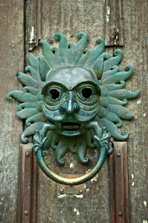 Antique door knocker at the front door of Durham, Cathedral, England photo