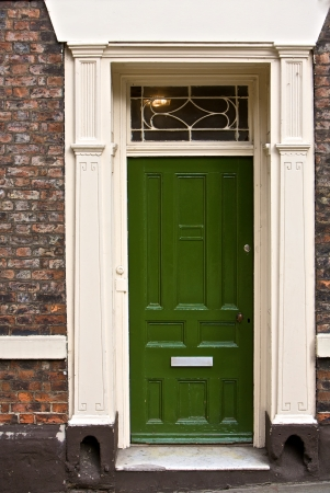 front entry: Green door, part of a home in London, England