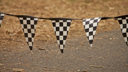 Racing flags in a race and fast cars photo