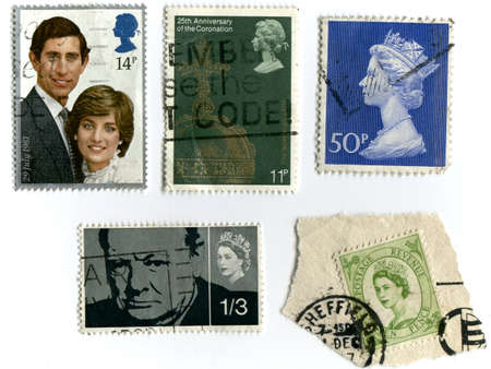 lady diana: UNITED KINGDOM - CIRCA 1981: A stamp printed in England shows an image of Wedding of HRH Prince Charles to Lady Diana Spencer 29 July 1981, circa 1981. Assortment of vintage stamps, Winston Churchill and Queen Elizabeths stamps  Editorial