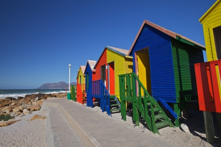 Colourful wooden cabins at the St James Beach, Cape Town, South Africa