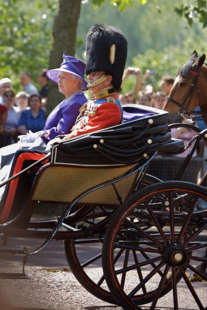 queen elizabeth ii: LONDON - JUNE 17  Queen Elizabeth II and Prince Philip seat on the Royal Coach at Queen s Birthday Parade on June 17, 2006 in London, England  Editorial