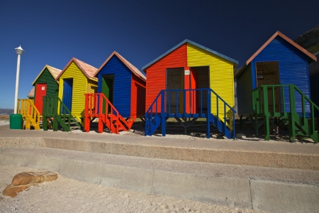 public house: Colourful wooden changing cabins at the Beach St James Beach, Cape Town, South Africa Stock Photo