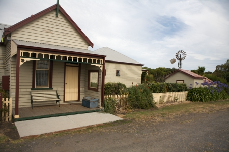 buliding: Typical wooden Australia house in a rural area farming and outback road