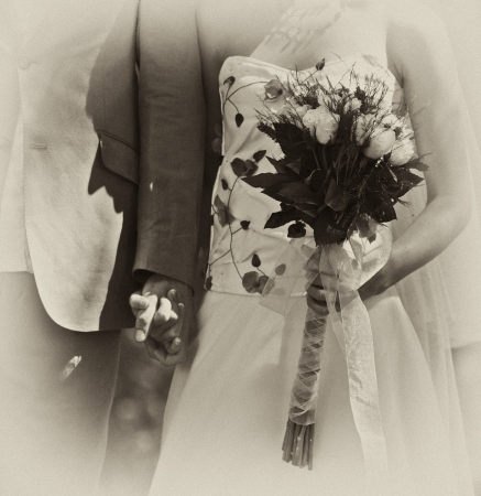 Wedding couple standing with bouquet photo