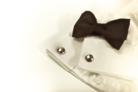 cuff: Bow and white shirt with cuff links, formal function