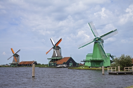 wind powered building: Very old authentic windmills in a row in Zaandam or Zaanse Schans, Neterhlands, Holland, Europe Very popular with the tourists and old are of Netherlands Editorial