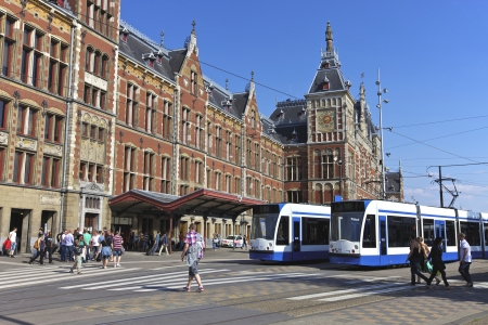 public service: Amsterdam Central Station and public transport and trams, Netherlands, Europe