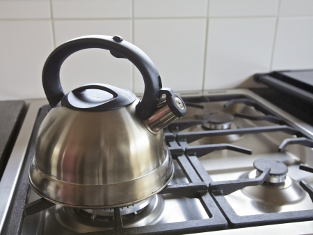 int: Kettle on a gas stove int a kitchen, home