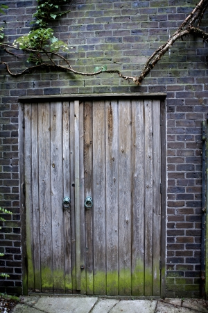 outbuilding: Old Weathered Door on a derelict outbuilding Stock Photo