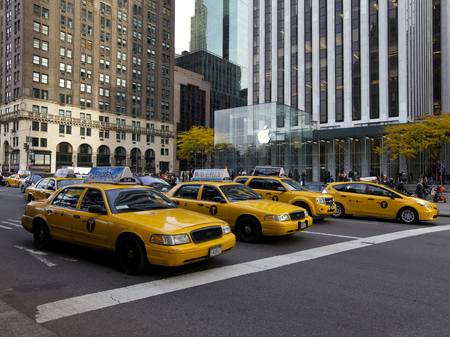 Yellow Cabs in front of Apple Store in New York, USA
