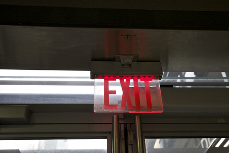 exit sign: Exit, Sign view above door, interior  Alert Warning Sign Stock Photo