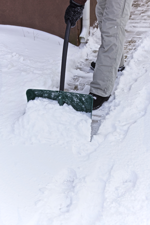 clearing: Person clearing snow, Winter Stock Photo
