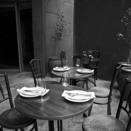 table setting: Afternoon setting at a restaurant in monochrome Stock Photo