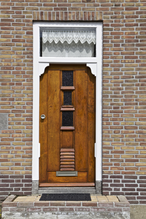 Wooden door part of a home, Netherlands, Europe