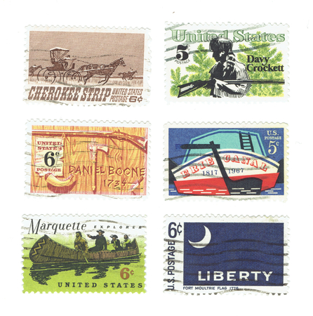 explored: USA - CIRCA 1967 - 1968: Arrange of used postage stamps printed in USA shows Stern of Erie Canal, Cherokee Strip of Kansas, Davy Crockett and Daniel Boone, Marquette explorer and the Fort Moultrie Flag, circa 1967 and 1968