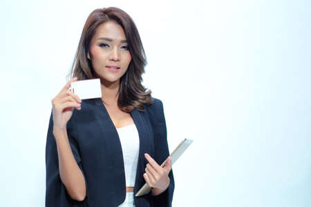 bankcard: Portrait beautiful asian woman standing, Hold tablet  and namecard On the white background