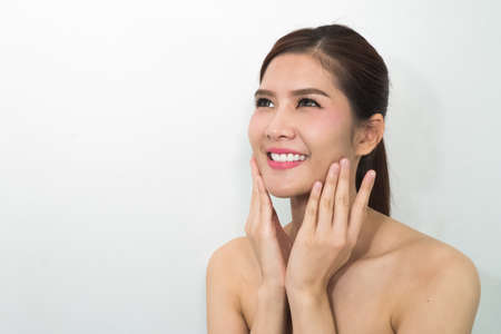doctor holding gift: The Asian beauty face, closeup portrait with clean and fresh elegant lady. Stock Photo