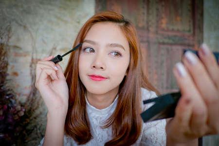 A girl with a mascara