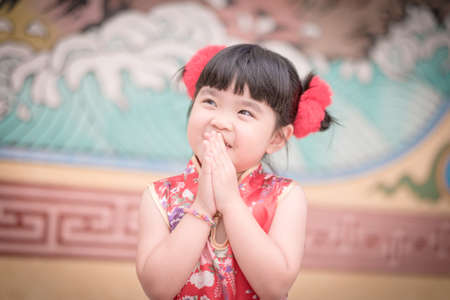 ambience: Cute girl wearing red Chinese suit,Photos provided by background ambience China .