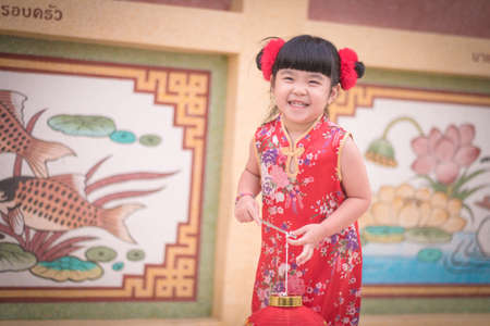 provided: Asian Chinese girl  in Traditional Chinese  hold red  paper lanterns,Photos provided by background ambience China .