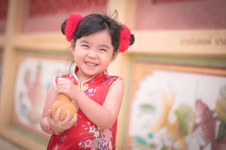 ambience: Asian Chinese girl in Traditional Chinese hold calabash,Photos provided by background ambience China .