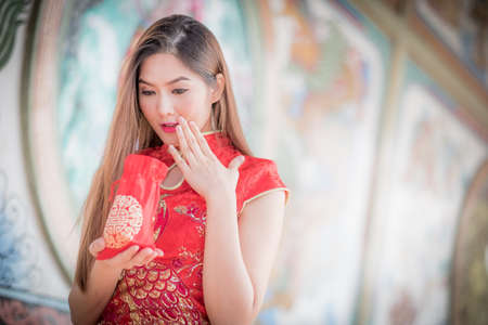 ambience: Asian Chinese woman in Traditional Chinese hold Gift Bag,by background ambience China . Stock Photo