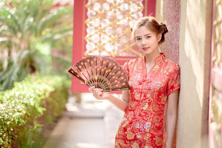 Asian Chinese woman in Traditional Chinese  hold  Fanning paper