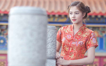 ambience: Asian Chinese woman in Traditional Chinese?by background ambience China . Stock Photo