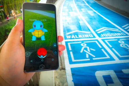 screenshot: BANGKOK, THAILAND - August 12,2016: Pokemon Go gameplay screenshot on the phone. Pokemon Go is a location-based augmented reality mobile game.